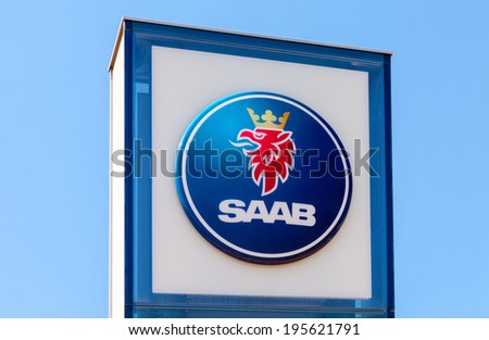 SAMARA, RUSSIA - MAY 24, 2014: The emblem SAAB over blue sky. Saab Automobile AB is a Swedish premium car manufacturer headquartered in Trollhattan, Sweden - stock photo