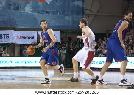 SAMARA, RUSSIA - MAY 20: Theodoros Papaloukas of BC CSKA, with ball, is on the attack during a BC Krasnye Krylia game on May 20, 2013 in Samara, Russia. - stock photo