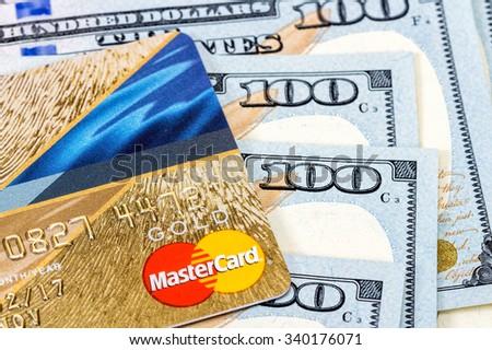 SAMARA, RUSSIA - NOVEMBER 15, 2015: MasterCard Credit Card with US dollar bills - stock photo