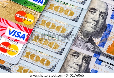 SAMARA, RUSSIA - NOVEMBER 15, 2015: Mastercard Debit Card, Visa with US Dollar bills - stock photo