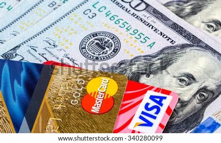 SAMARA, RUSSIA - NOVEMBER 15, 2015: Visa and MasterCard with US dollar bills - stock photo