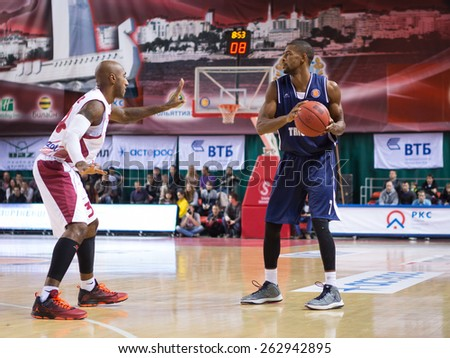 SAMARA, RUSSIA - OCTOBER 22: Cory Higgins of BC Triumph with ball goes against a BC Krasnye Krylia player on October 22, 2013 in Samara, Russia. - stock photo