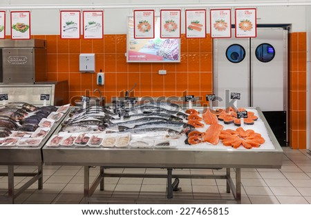 SAMARA, RUSSIA - OCTOBER 26, 2014: Raw fish ready for sale in the supermarket Magnit. One of largest retailer in Russia - stock photo