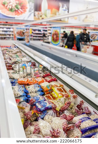 SAMARA, RUSSIA - OCTOBER 5, 2014: Showcase with frozen products in supermarket Magnit. Russia's largest retailer. It was founded in 1994 in Krasnodar. - stock photo