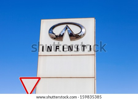 SAMARA, RUSSIA - OCTOBER 20: The emblem INFINITI on blue sky background, October 20, 2013 in Samara, Russia. Infiniti is the luxury vehicle division of Japanese automaker Nissan Motor Company