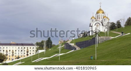 SAMARA,  RUSSIA - SEPTEMBER 19 2013:  Orthodox church of St. Georges the Victorious  against the storm autumn sky. The first stone of construction has been put in 1999 - stock photo