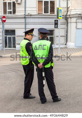 SAMARA, RUSSIA - SEPTEMBER 11, 2016: Russian police patrol officers of the State Automobile Inspectorate regulate traffic on city street
