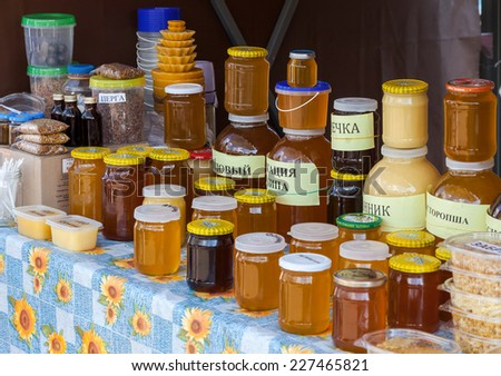 SAMARA, RUSSIA - SEPTEMBER 7, 2014: Sweet fresh honey ready for sale at the traditional farmers market