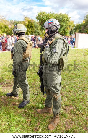 SAMARA, RUSSIA - SEPTEMBER 11, 2016: Unidentified members of military club in camouflage army uniform and helmet (full gear) during military reenacting in Samara, Russia