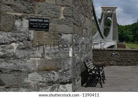 Samaritan sign on high suspension bridge - stock photo