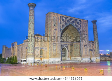 SAMARKAND, UZBEKISTAN - MAY 1, 2015: The rainy weather in the evening Samarkand makes glazed tile even more shiny in the bright lights, on May 1 in Samarkand.