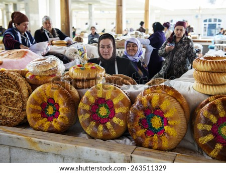 SAMARQUAND, UZBEKISTAN - MARCH 14, 2015: City grocery market.  Women sell traditional Uzbek bread. - stock photo