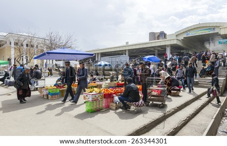 SAMARQUAND, UZBEKISTAN - MARCH 23: Unidentified people shoping on the main market on March 23, 2012 in Samarquand, Uzbekistan. The ancient city is part of UNESCO World Heritage.