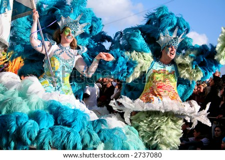 Samba Dancers parade in the Carnival – equal to the Brazilian Carnival. Sesimbra Town, Portugal, Feb. 2007 - stock photo