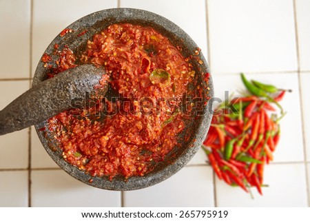 Sambal and its main ingredients, chili - stock photo