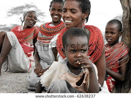SAMBURU,KENYA-NOVEMBER 8:Samburu  woman with her children all smiling,portrait of an African family,review of daily life of local people,near Samburu Park National Reserve on Nov 8, 2008 in Kenya - stock photo