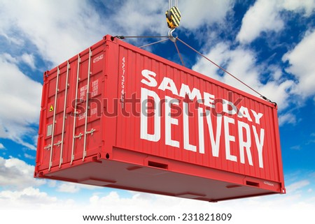 Same Day Delivery - Red Hanging Cargo Container on Sky Background. - stock photo