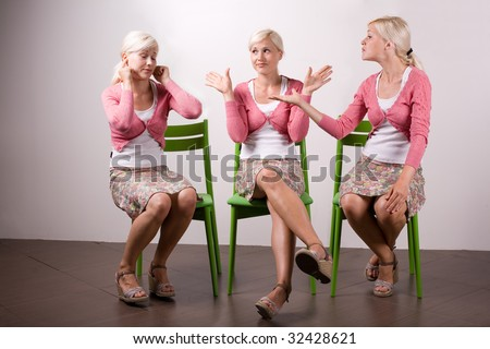 Same woman fighting with herself. One is arguing, the other is not listening and third is neutral, ego,  quarrel - stock photo