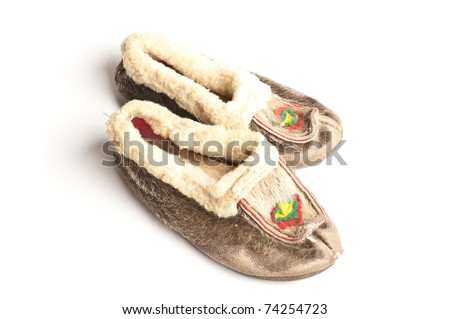 Sami shoes made of reindeer fur isolated on white background - stock photo