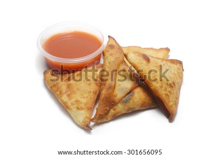 samosa snacks with chili sauce - stock photo