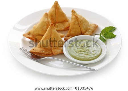 samosa with fresh mint dipping sauce , indian food - stock photo