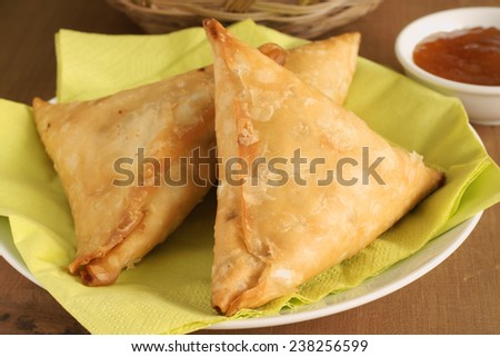 Samosas a spicy blend of vegetables or meat wrapped in a deep fried triangular pastry parcel
