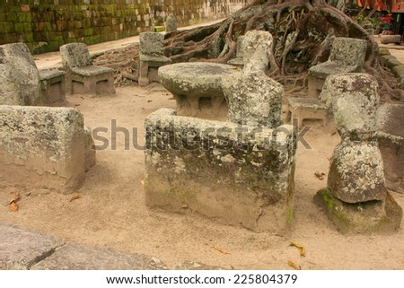 SAMOSIR, INDONESIA - MARCH 6: Ancient stone chairs on March 6, 2012  on Samosir island, Indonesia. Samosir is the largest island within an island and the fifth largest lake island in the world. - stock photo