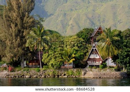 Samosir, Tuk Tuk at lake Toba on Sumatra, Indonesia - stock photo