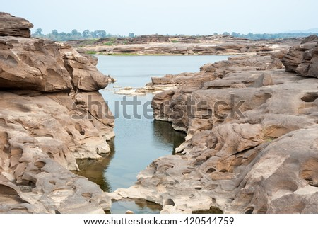 Sampanbok (3000 Hole), The Amazing of Rock in Mekong River, Ubon Ratchathani, Thailand. - stock photo