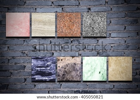 sample marble plate on brick wall - stock photo