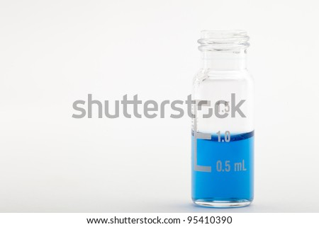 Sample vial for chromatography filled with one milliliter of blue liquid. Isolated on white. Please see my portfolio to find more similar images - stock photo
