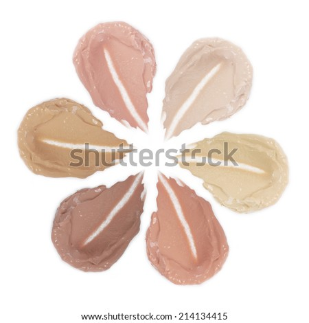 Samples foundation of different colors isolated on white background - stock photo