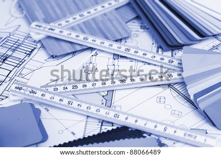 samples of architectural materials - plastics, metric folding ruler and architectural drawings of the modern house