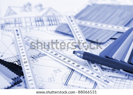 samples of architectural materials - plastics,  metric folding ruler, pencil & architectural drawings of the modern house