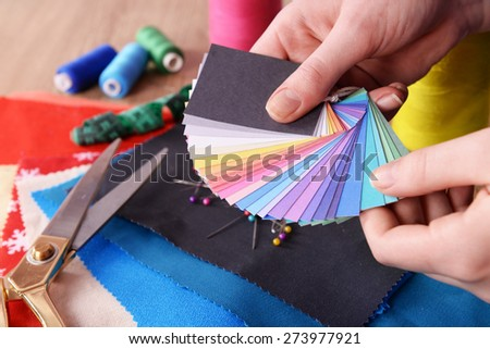 Samples of colorful fabric in female hands, closeup - stock photo