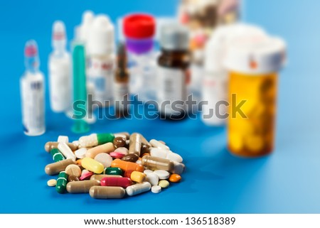 Samples of medicines, tablets, capsules, vitamins, and placebo - stock photo