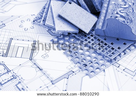 samples of plastics, PVC, for furnishing, artificial stone, perforated metal, coated with a polymer and architectural plans for houses - stock photo