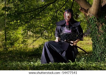 Samurai sitting under the tree - stock photo