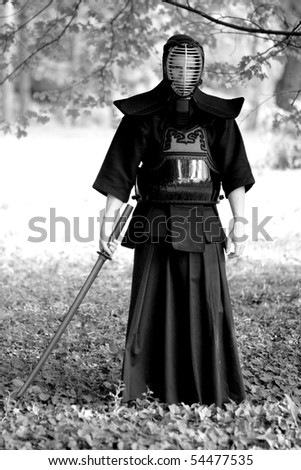 Samurai standing in the forest - stock photo