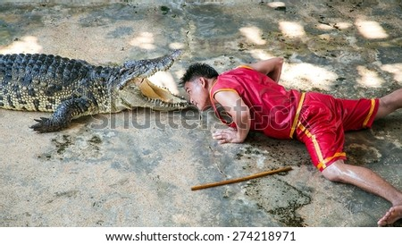 SAMUT PRAKAN, THAILAND - APRIL 28: The crocodile show at Samut Prakan Crocodile Farm and Zoo on April 28, 2015 in Samut Prakan. - stock photo