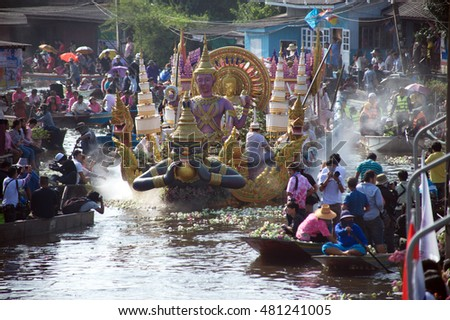 SAMUT PRAKAN,THAILAND-OCT 26,2015:Lotus throwing into the boat (Rup Bua Festival)in Samut Prakan,Thailand.Devotees throw lotus flowers to boat procession that carry Buddha on the end of Buddhist Lent.