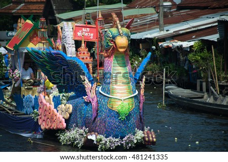 SAMUT PRAKAN , THAILAND â?? OCTOBER 26, 2015 : Beautiful flower boats in floating parade,the unique annual Rup Bua Festival ( Lotus Throwing Festival ) on end of Buddhist lent in,Samut Prakan ,Thailand.
