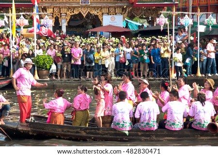 SAMUT PRAKAN,THAILAND â?? OCTOBER 3,2009 : people enjoy and dancing the Lotus throwing procession by the river ceremony on End of Buddhist Lent Day in Rub Bua Festival ,Samut Prakan Province, Thailand.