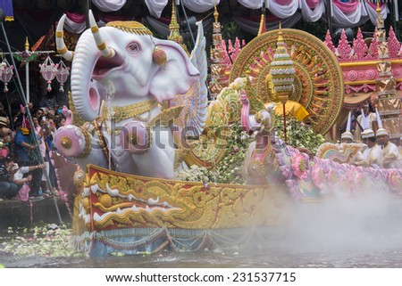 Samut Prakarn,Thailand-October 7, 2014:The floating parade in Lotus Giving Festival(Rab Bua) in Samut Prakarn,Thailand. Devotees throw lotus flowers to boat procession that carry Buddha statue.