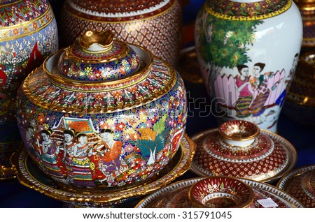 SAMUT SAKHON, THAILAND - AUGUST 8 : Craft Benjarong is traditional thai five basic colors style pottery for show and sell at Ban Don Kai Dee on August 8, 2015 in Samut Sakhon Thailand.