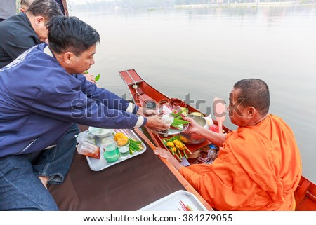 SAMUT SONGKHRAM - MARCH,1 :Thai tradition make offering for Buddhist monk on boat in morning at Mae Klong River .THAILAND MARCH,1 2016 - stock photo