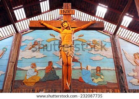 SAMUT SONGKHRAM, THAILAND - NOVEMBER 08, 2014 : Jesus Christ On Christian Wooden Cross at woodland museum, samut songkhram,Thailand - stock photo