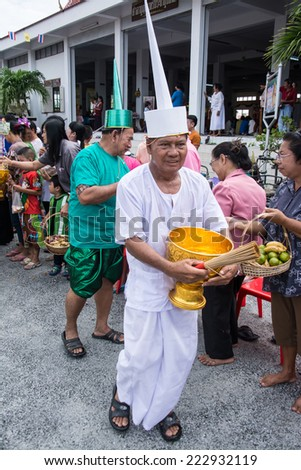 SAMUTPRAKARN, THAILAND - OCT 09 :  old men dress like a deva join at Buddhist monks  for End of Buddhist Lent Day. on October 09, 2014 in Samutprakarn,Thailand.