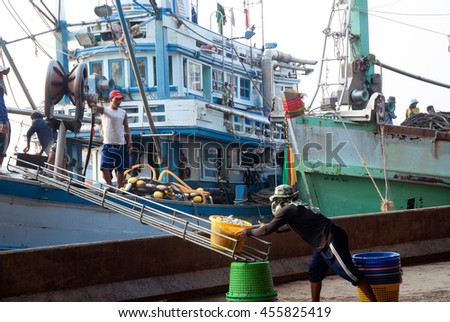 SAMUTSAKORN, THAILAND-SEPTEMBER 17, 2009: Worker is working on fishing boat at Talaythai seafood market, Trading center of fish and seafood products on September 17, 2009 in Samutsakorn, Thailand. - stock photo