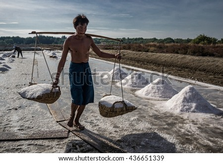 SAMUTSONGKRAM,THAILAND, June 13, 2016 Ended a summer season farmers salt to carry salt from the salt farm to piles are to be sold in the next step.
